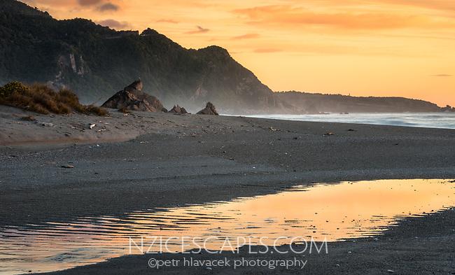 Sunset with reflections on beach near Punakaiki, Paparoa National Park, Buller Region, West Coast, New Zealand, NZ