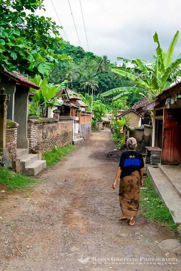 Bali, Karangasem, Tenganan. A traditional Bali Aga village. Tenganan is located on the fertile hills stretching up to Gunung Agung. An old woman in a Tenganans street.