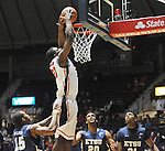 "Mississippi's Reginald Buckner (23) dunks against East Tennessee State's Lester Wilson (15), East Tennessee State's Hunter Harris (20), and East Tennessee State's John Walton (21) at the C.M. ""Tad"" Smith Coliseum in Oxford, Miss. on Saturday, December 14, 2012.  (AP Photo/Oxford Eagle, Bruce Newman).."