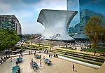 The aluminium paneled Soumaya Musuem stands in Plaza Carso in the Polanco district of Mexico City. The art museum/cultural institution has works from over 30 centuries of art. In the foreground workers on their lunch break enjoy a game of ping pong in the plaza.