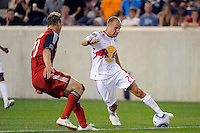 Joel Lindpere (20) of the New York Red Bulls is defended by Ty Harden (20) of Toronto FC. The New York Red Bulls defeated Toronto FC 5-0 during a Major League Soccer (MLS) match at Red Bull Arena in Harrison, NJ, on July 06, 2011.