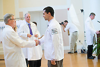Dean Rick Morin, M.D., left, Alejandro Castro. Class of 2016 White Coat Ceremony.