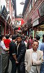 Asia, China; Shanghai. A crowded pedestrian way at Yu Gardens in Shanghai.
