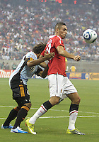 Kevin Alston #30 of the MLS All-Stars pushes into the back of Fredrico Macheda #27 of Manchester United during the 2010 MLS All-Star match at Reliant Stadium, on July 28 2010, in Houston, Texas. Manchester United won 5-2.
