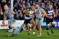 Anthony Watson of Bath Rugby takes on the Northampton Saints defence. Aviva Premiership match, between Bath Rugby and Northampton Saints on December 5, 2015 at the Recreation Ground in Bath, England. Photo by: Patrick Khachfe / Onside Images