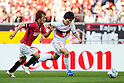 Shunki Takahashi (Reds), Shohei Abe (Grampus), APRIL 24th, 2011 - Football : 2011 J.League Division 1 match between Urawa Red Diamonds 3-0 Nagoya Grampus Eight at Saitama Stadium 2002 in Saitama, Japan. The J.League resumed on Saturday 23rd April after a six week enforced break following the March 11th Tohoku Earthquake and Tsunami. All games kicked off in the daytime in order to save electricity and title favourites Kashima Antlers are still unable to use their home stadium which was damaged by the quake. Velgata Sendai, from Miyagi, which was hard hit by the tsunami came from behind for an emotional 2-1 victory away to Kawasaki. .(Photo by AFLO)