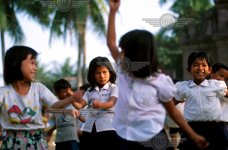 Primary school children in an exercise class at the start of the school day.