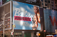 A billboard in Times square in New York on Tuesday, February 11, 2014 features the iconic Barbie® doll in her black and white swimsuit. The Mattel advertisement is promoting the appearance of Barbie® in the 2014 Sports Illustrated Swimsuit issue which will be released February 18. The issue is celebrating its 50th anniversary and is will have an assemblage of models the have appeared in it over the years. This is Barbie's® first appearance and a shoot featuring 22 of the dolls will appear. (© Richard B. Levine)