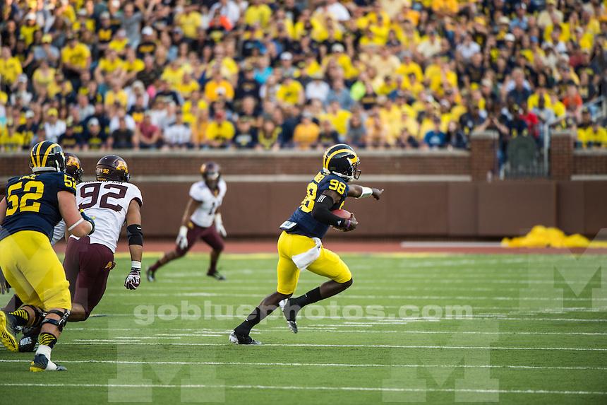 The University of Michigan football team loses to Minnesota, 30-14, at Michigan Stadium on Sept. 27, 2014.