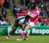 Hugh Pyle of Stade Francais is tackled by Manu Tuilagi of Leicester Tigers. European Rugby Champions Cup quarter final, between Leicester Tigers and Stade Francais on April 10, 2016 at Welford Road in Leicester, England. Photo by: Patrick Khachfe / JMP