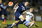 06 October 2015: UNCW's Colin Bonner (23) and North Carolina's Alex Comsia (CAN) (4). The University of North Carolina Tar Heels hosted the University of North Carolina Wilmington Seahawks at Fetzer Field in Chapel Hill, NC in a 2015 NCAA Division I Men's Soccer match. North Carolina won the game 3-0.