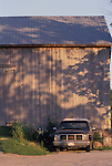 Farm Pickup Truck in Front of Barn on Sunny Summer Evening