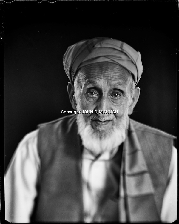 """Abdulhadi, 83, a woodcarver and teacher, is seen at the Turquoise Mountain Foundation in Kabul, 26 August 2012. This portrait was shot on a 5x4 Linhof Technika IV, circa 1959, and a Schneider Kreuznach 270mm lens, circa 1952, with front tilt, and is part of a series entitled """"Putting an Afghan face on the war."""" (John D McHugh)"""