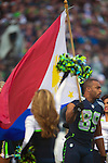 Seattle Seahawks  wide receiver Doug Baldwin carries The National Flag of the Philippines onto the field before their game against the Minnesota Vikings at CenturyLink Field in Seattle, Washington on  November 17, 2013.  The Seahawks beat the Vikings 41-20.  ©2013.  Jim Bryant. All Rights Reserved.
