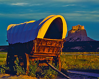 Covered Wagon at Sunset in Summer, Oregon, California & Mormon Pioneer Trails, Scotts Bluff National Monument, Nebraska