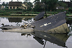 Ducks stroll on a broken tail section of a B-52, purportedly downed by a missile on 27 December 1972. It crashed, the guide says, in a community pond in Hanoi, North Vietnam. (Jim Bryant Photo).....