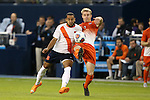 11 December 2015: Clemson's Kyle Fisher (right) clears the ball from Syracuse's Ben Polk (7). The Clemson University Tigers played the Syracuse University Orange at Sporting Park in Kansas City, Kansas in a 2015 NCAA Division I Men's College Cup Semifinal match. The game ended in a 0-0 tie after overtime; Clemson advanced to the Final by winning the penalty kick shootout 4-1.