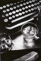 Still life with typewritter, drinking glass and ashtray