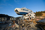 A pleasure boat sits atop a building after being washed inland by the March 11 tsunamis in Otsuchi, Iwate Prefecture, Japan. Photographer: Robert Gilhooly