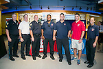 From left, TUPD Cpl. Anthony Regan, Medford Fire Dep. Chief Scott Graham, TUPD Sgt. Duane Weisse, Medford firefighters Steve Pina and Tom Murray, Tufts Fire Marshal student employee Montane Silverman, A16, and Medford firefighter Janelle Maietta pose for a photo at Carmichael Dining Hall for Tufts Dining and Public Safety's Chili Fest. (Kelvin Ma/Tufts University)