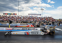 Jul 23, 2016; Morrison, CO, USA; NHRA top fuel driver Antron Brown (near) races alongside Doug Kalitta during qualifying for the Mile High Nationals at Bandimere Speedway. Mandatory Credit: Mark J. Rebilas-USA TODAY Sports