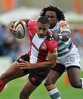 Ashley Smith is tackled by Marland Yarde. J.P. Morgan Premiership Rugby 7s match, between London Irish and London Welsh on August 3, 2012 at the Recreation Ground in Bath, England. Photo by: Patrick Khachfe / Onside Images