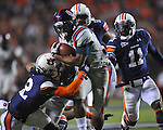 Ole Miss' Brandon Bolden (34) runs vs. Auburn defensive back Demetruce McNeal (12), Auburn defensive back T'Sharvan Bell (22), and Auburn cornerback Chris Davis (11) at Jordan-Hare Stadium in Auburn, Ala. on Saturday, October 29, 2011. .