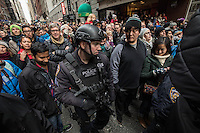 NEW YORK, NY - NOVEMBER 24:  Police walk into the crowd as people watch the 90th annual Macy's Thanksgiving Day Parade on November 24, 2016 in New York City.  Photo by VIEWpress/Maite H. Mateo.