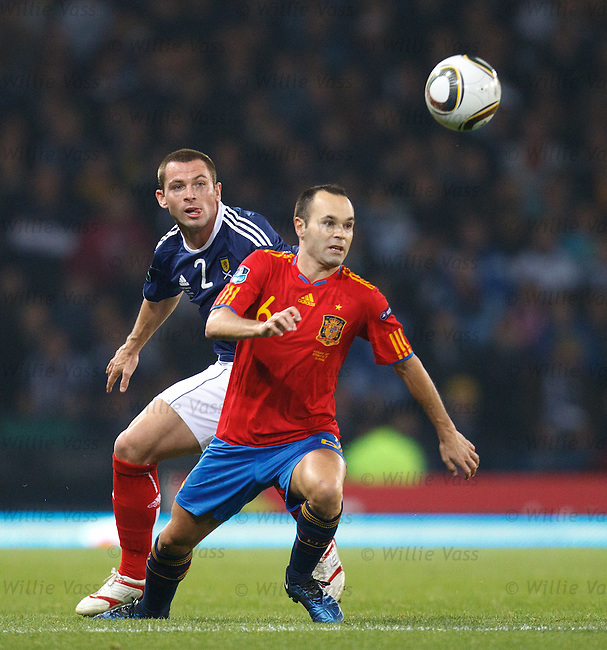 Phil Bardsley with Iniesta