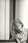 1976. Young woman looking contemplative and serious.