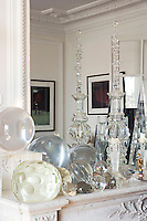A detail of the marble mantelpiece in the living room on which a fascinating collection of glass and crystal objects is displayed
