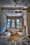Derelict asylum interior with bath