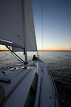 Couple Sailing on sailboat drinking champagne during sunset on the Charleston Harbor Beneteau 49 yacht