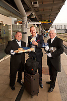 Pictured handing out free bacon butties to promote East Midlands Trains complimentary breakfast for First Class passengers are the singing butlers Alberto and Maxwell with JAck Wilson of Clifton, Derbyshire