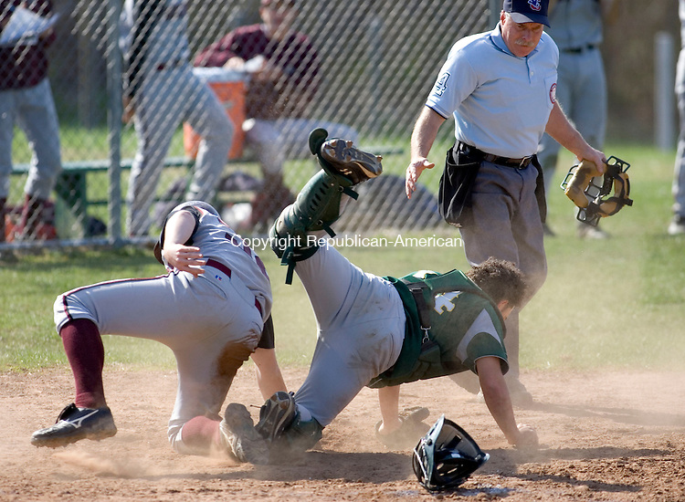 WATERBURY, CT- 21 APRIL 2008- 042108JT07-<br /> Torrington's Steve Denza crawls from underneath Holy Cross catcher Christian Cuevas after Denza scored a run during Monday's game at Holy Cross. Holy Cross won 21-6.<br /> Josalee Thrift / Republican-American