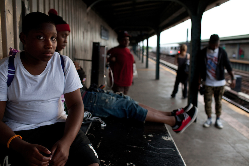 Shatike Robinson, 12, waits for the A train at Rockaway Ave subway stop in Brooklyn, NY on June 24, 2012.
