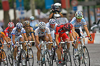 AG2R Professional cyclist Christophe Riblon, rides amongt a small breakaway on the Champs Elysees in Paris, France