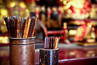 A detail shot of prayer sticks in a Chinese temple. These sticks are shaken by the person praying until one falls out and then the person's fortune is read, usually by a priest.