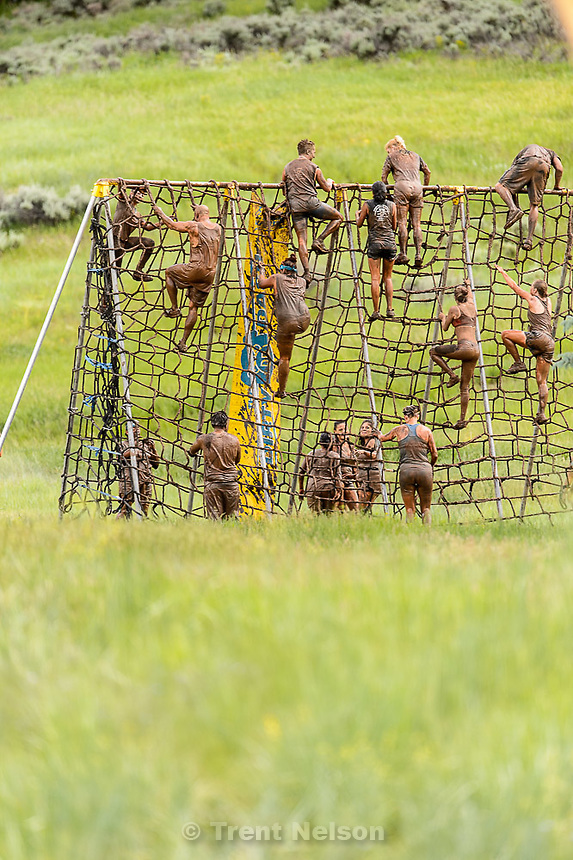 Trent Nelson     The Salt Lake Tribune<br /> Runners climb a cargo net at the Dirty Dash, held at Soldier Hollow, Saturday June 6, 2015.