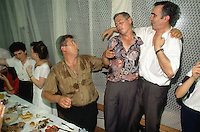 Kosovo. Village of Gaglavica. Farewell party for a young serb man joining the army in order to become a soldier. Men celebrate, drink together and stand up on their chairs. Kosovo (Albanian: Kosova) is a province of Serbia. While Serbia's sovereignty is recognised by the international community, in practice Serbian governance in the Kosovo province is virtually non-existent.  &copy; 1995 Didier Ruef