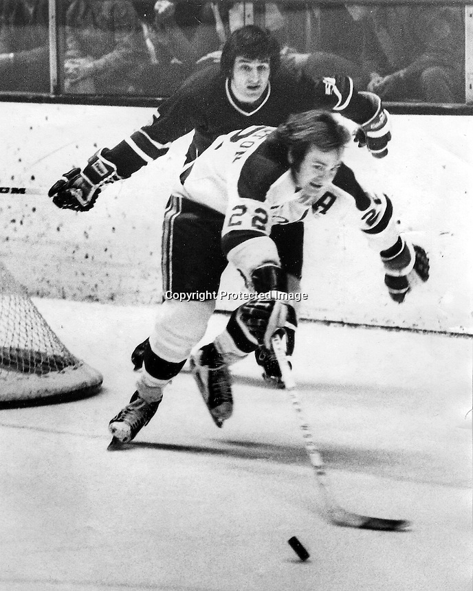 California Golden Seal Joey Johnston #22 chases puck. (1974 photo/Ron Riesterer)