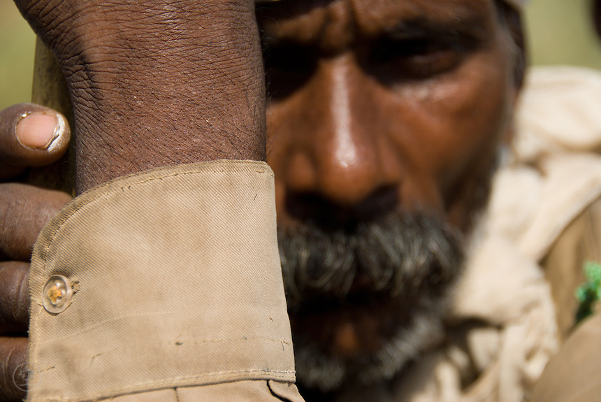 Portrait of a male Janadesh 2007 Marcher waiting patiently on the road to Delhi