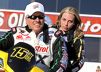 Feb. 14, 2013; Pomona, CA, USA; NHRA top fuel dragster driver Brittany Force (right) with father John Force during qualifying for the Winternationals at Auto Club Raceway at Pomona.. Mandatory Credit: Mark J. Rebilas-