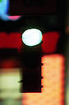 Traffic signal at night, green illuminated (defocussed)
