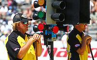 Jun. 2, 2013; Englishtown, NJ, USA: NHRA Safety Safari crew members on the starting line during the Summer Nationals at Raceway Park. Mandatory Credit: Mark J. Rebilas-