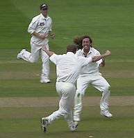 Photo Peter Spurrier.31/08/2002.Cheltenham & Gloucester Trophy Final - Lords.Somerset C.C vs YorkshireC.C..Somerset batting Ryan Sidebottom is congratulated by Antony McGarth after bowling Ian Blackwell;