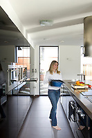 Lisa Manifold photographed in relaxed mood preparing dinner in the kitchen of her contemporary house in Nottingham