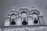 Looking up at church bells in Mykonos.