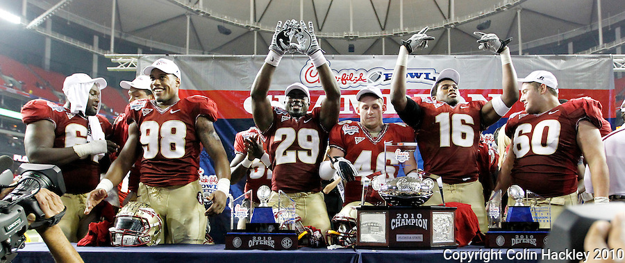ATLANTA, AG 12/31/10-FSU-SC FB10 CH-Florida State players celebrate beating South Carolina 26-17 Friday at the Chick-fil-A Bowl in Atlanta. .COLIN HACKLEY PHOTO