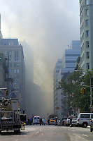 13 September 2001: Smoke rises at Ground Zero following the Terrorist attack on the America's.  Lower Manhattan, NY. Area surrounding ground zero where the World Trade Centers WTC once stood only hours after they fell to the ground in New York.  Islamic terrorist Osama bin Laden declares The Jihad or Holy War against The United States of America on September 11, 2001. Headline news photos available for editorial use.